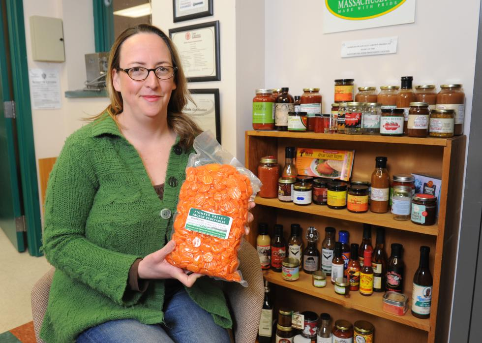 Nico Lustig of Shelburne Falls is the Food Business Development Specialist at the CDC Western Massachusetts  Food Processing Center in Greenfield with just some of the foods made there.  Recorder/Paul FranzRecorder/Paul Franz - PAUL FRANZ                       |