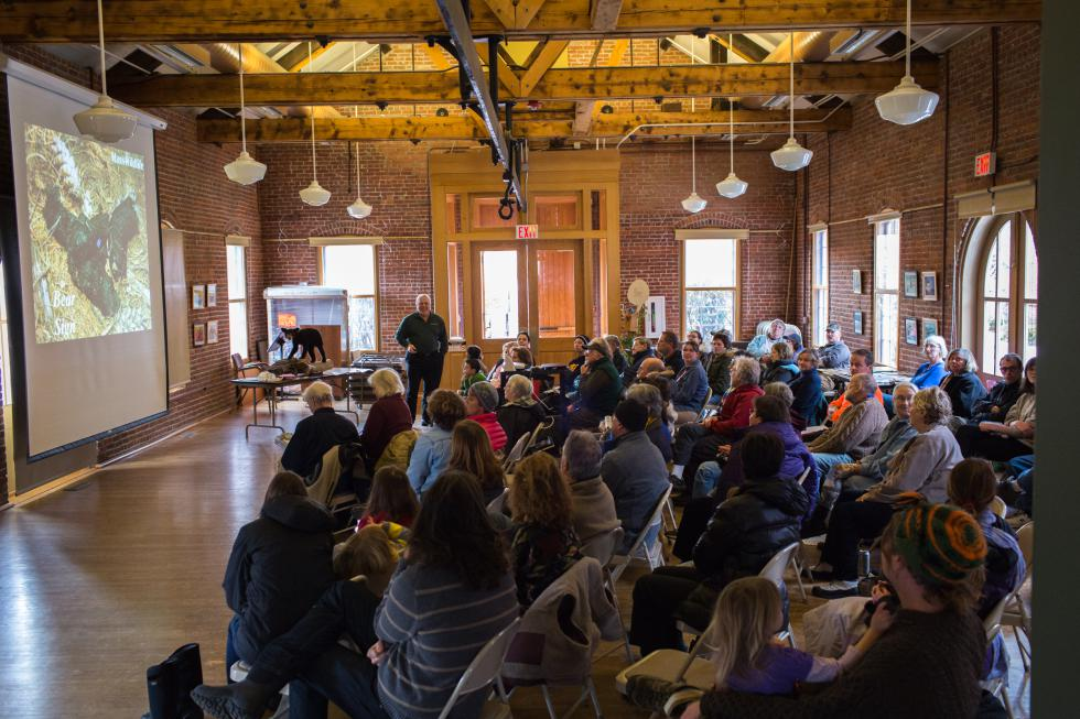 Attendees of the presentation on black bears in the area by Ralph Taylor, the MassWildlife Connecticut Valley District Supervisor, fill the Great Hall at the Discovery Center in Turners Falls, Saturday, January 23. Recorder Staff/Matt Burkhartt - Matt Burkhartt |