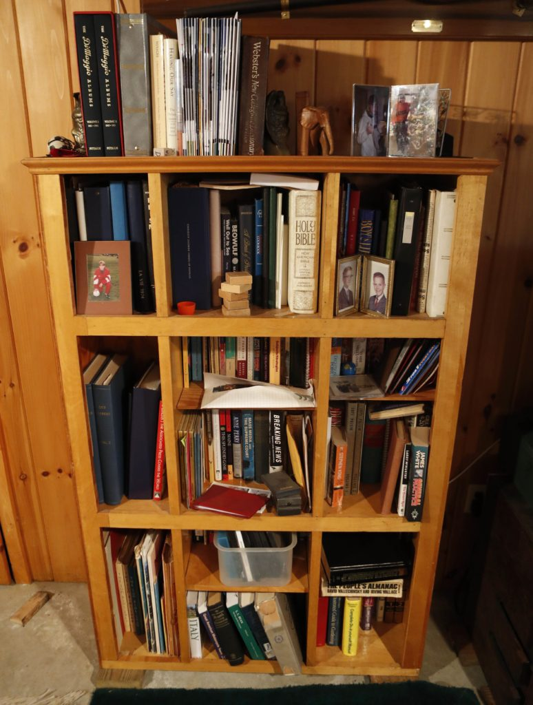 This  discarded snack bar counter  was converted into a book shelf by Glenn Adams, at his home in Augusta, Maine.