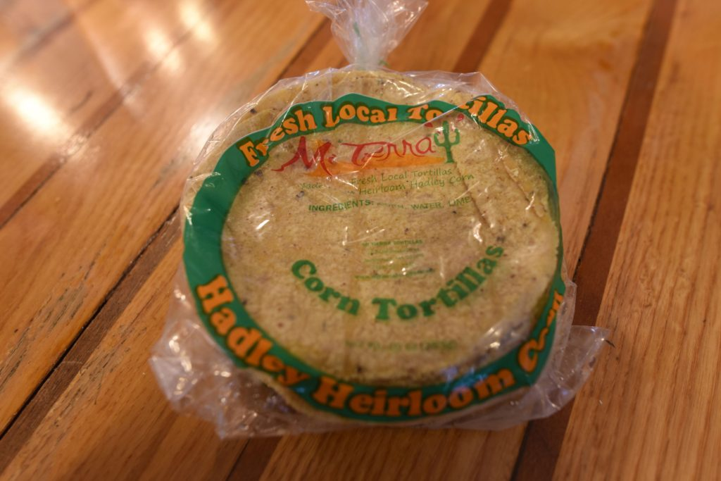 "Locally made corn tortillas from  Mi Tierra, whose owner, Jorge Sosa, says, ""Tortillas are not just a disk you put food on."""
