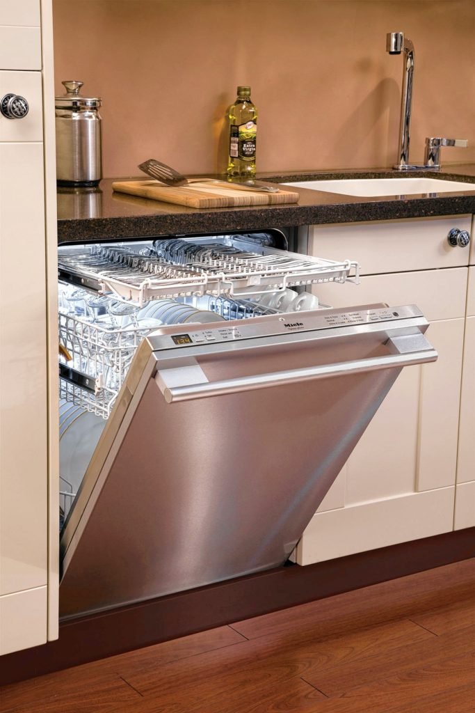 Stainless steel exterior has thin coating of glass for easier cleaning. The interior tub is also made of stainless steel.
