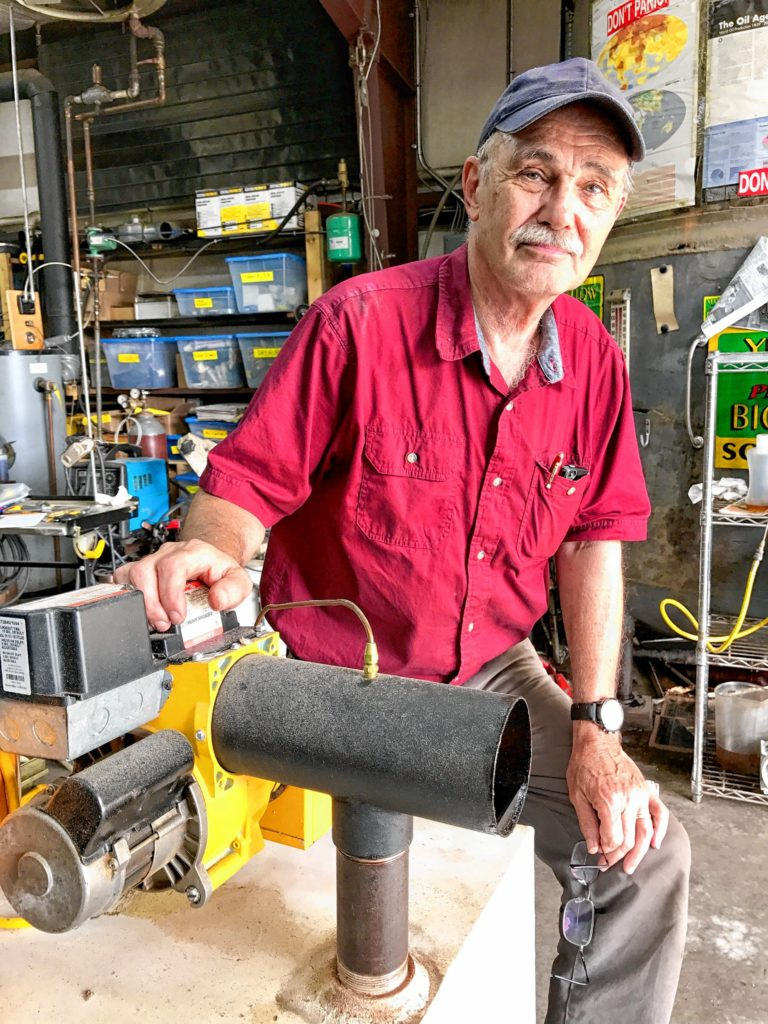 Tom Leue of Ashfield stands beside his prototype Yellow Heat burner.