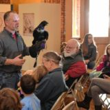 Local children learn about big-brained birds