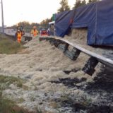 Truck dumps 40,000 pounds of chicken feathers on highway