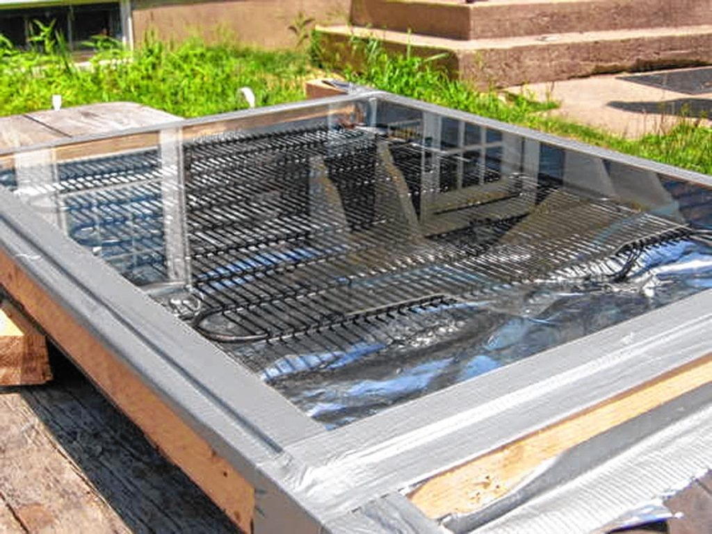 Condenser coils from an old refrigerator can be used to collect solar heat for warming water.