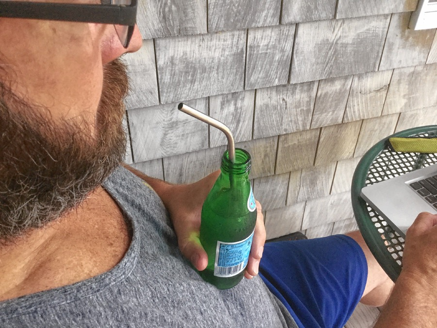 Dave Noonan sips through a stainless steel straw. Stainless steel straws are lightweight, durable and reusable. Good for sipping on hot or cold drinks, these straws are fairly inexpensive and can be outfitted with silicone tips, if desired.