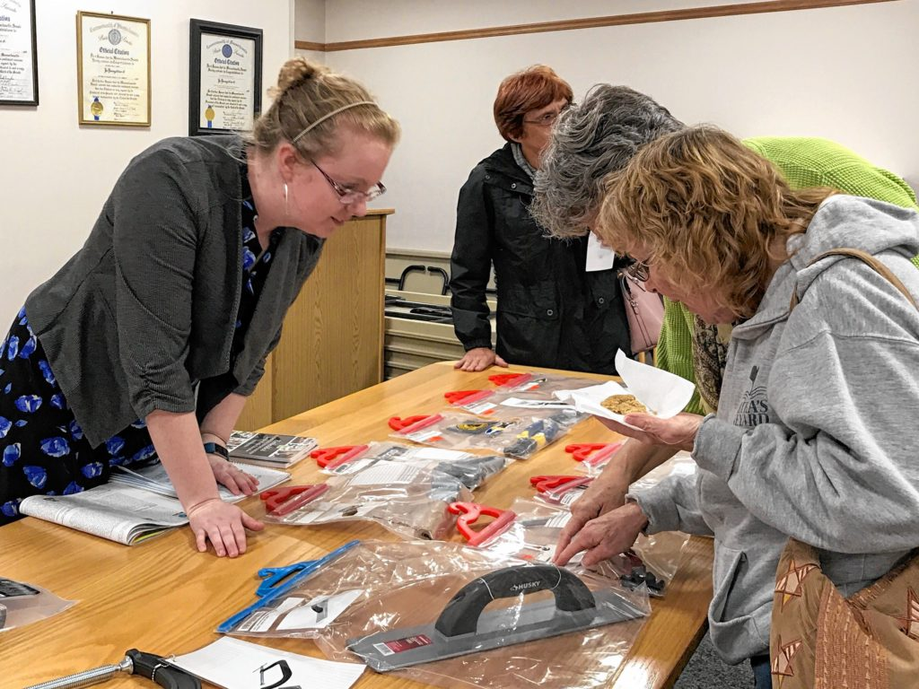 Southwick Public Library Director Lynn Blair examines a slate of tools available to residents to borrow with their library cards. The basis of the program is sharing and reusing resources rather than consuming them.