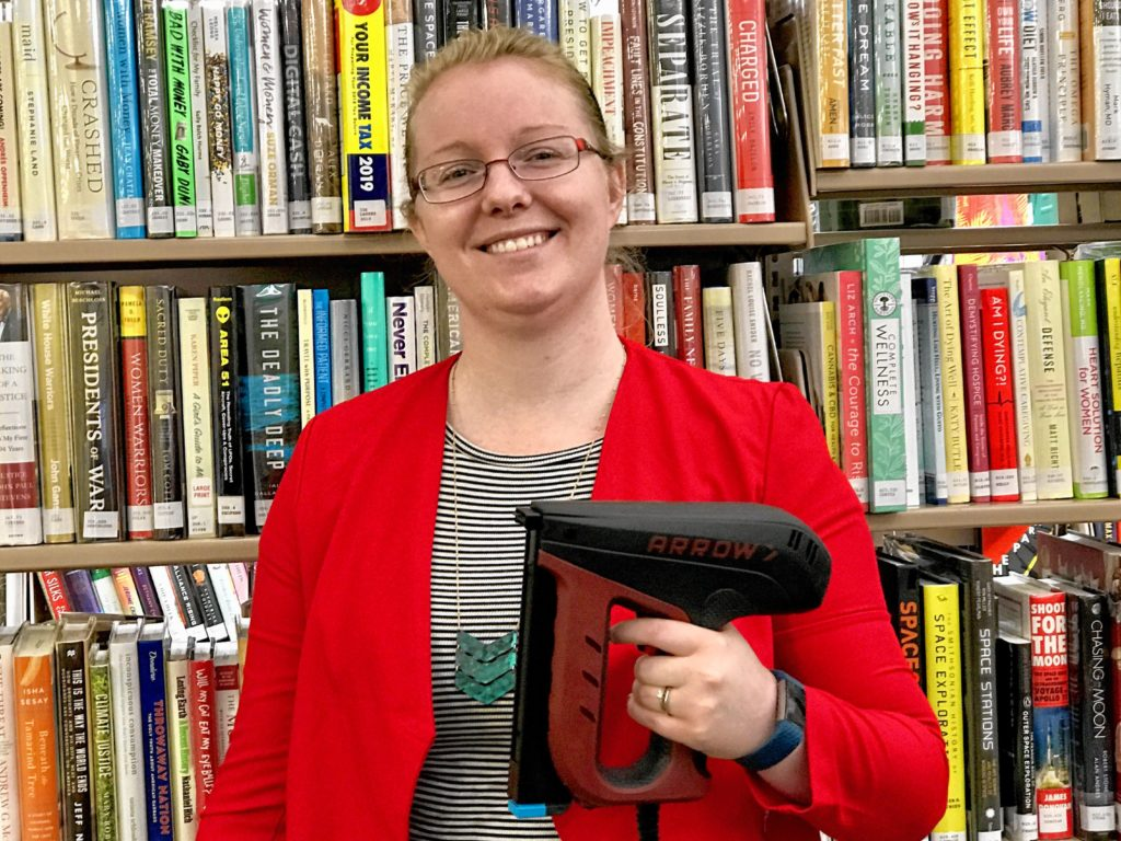 Lynn Blair, director of the Southwick Public Library, holds up a dual electric staple and nail gun available for loan at this Hampden County library. Increasingly, libraries are reducing the need to buy by offering practical items for loan, instead. But don't worry, Blair says. Libraries will continue to lend books, too.