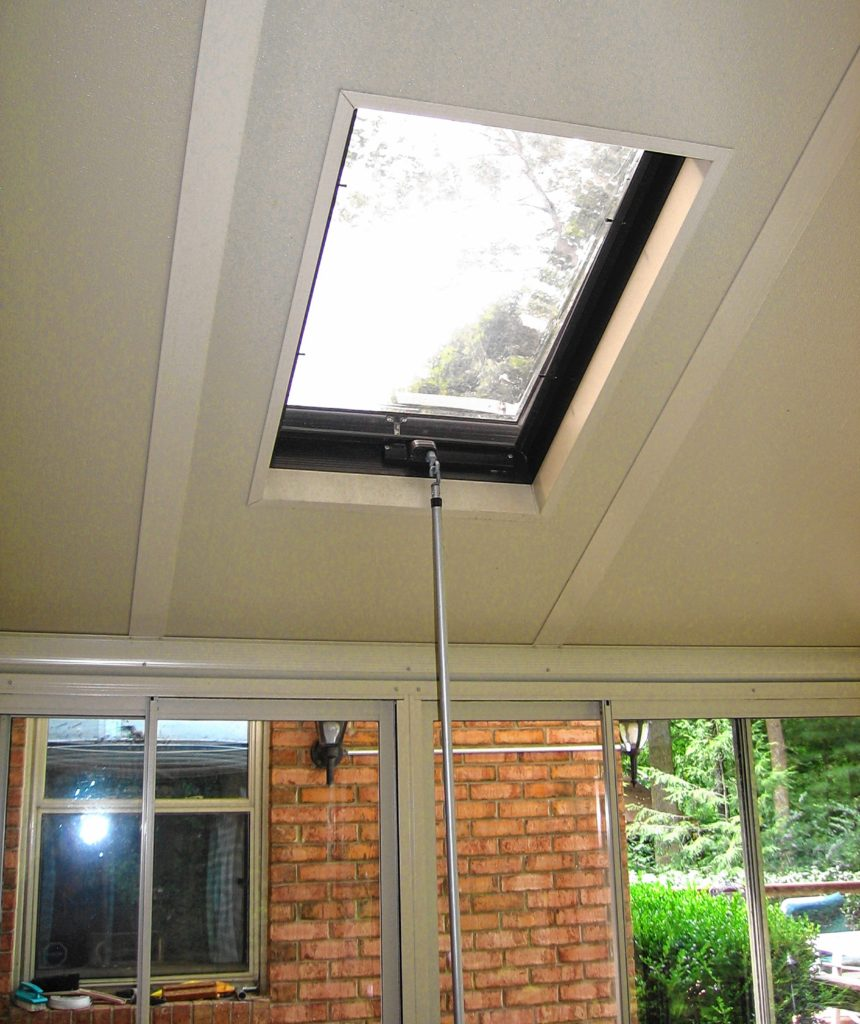 This is a venting triple-pane domed skylight in the solid sunroom roof to vent out excess hot air during summer.