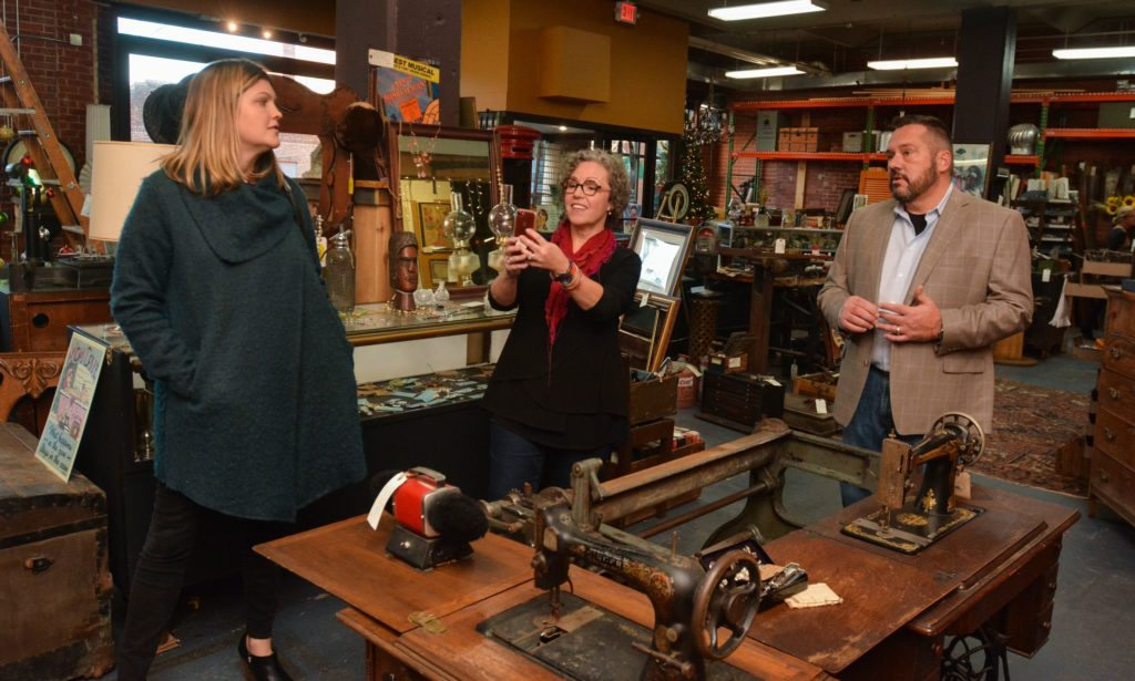 Emily Estes, left, an architect and interior designer, and Amy Woolf, an interior designer, talk with Ron Pike at his store, Castle Architectural Salvage in Northampton.