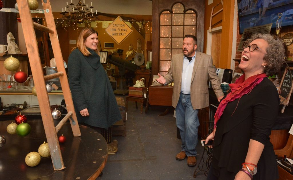 Emily Estes, left, an architect and interior designer, and Amy Woolf, an interior designer, talk with Ron Pike at his store, Castle Architectural Salvage in Northampton, Thursday, Nov. 21, 2019.